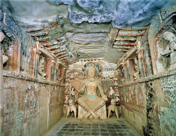 Cave 275, view of the interior and sculpture of a bodhisattva, Northern Liang dynasty (420 429 CE), Magao caves, Dunhuang China. Photo by Wu Jian. © Dunhuan Academy
